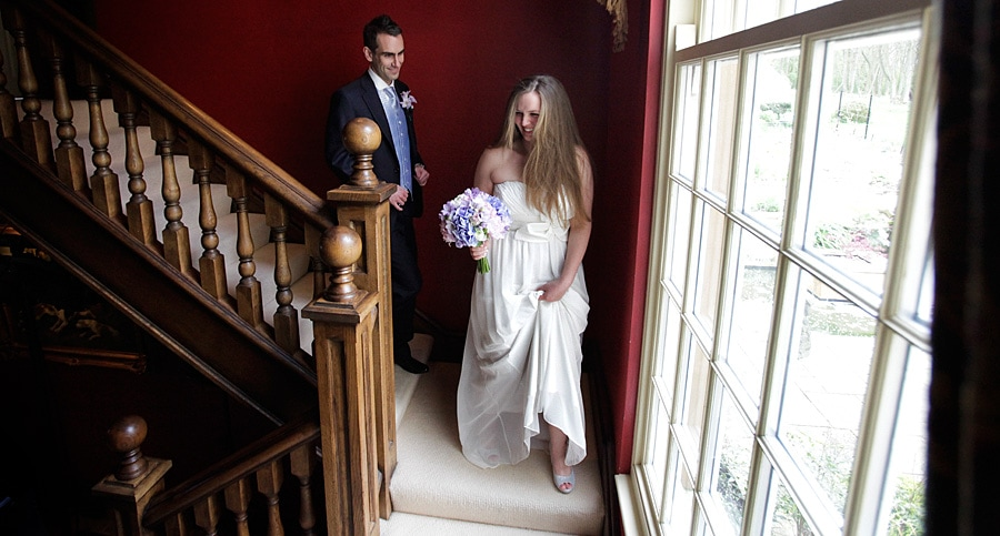 ladywood estate wedding photography with the bride and groom on the stairs