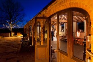 dodmoor house wedding photography, couple kiss in the barn