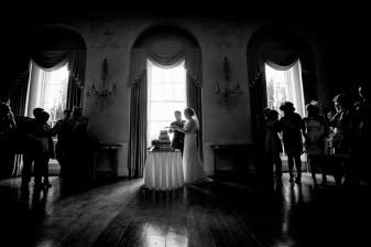 cutting the cake at a wedding at Kelmarsh Hall