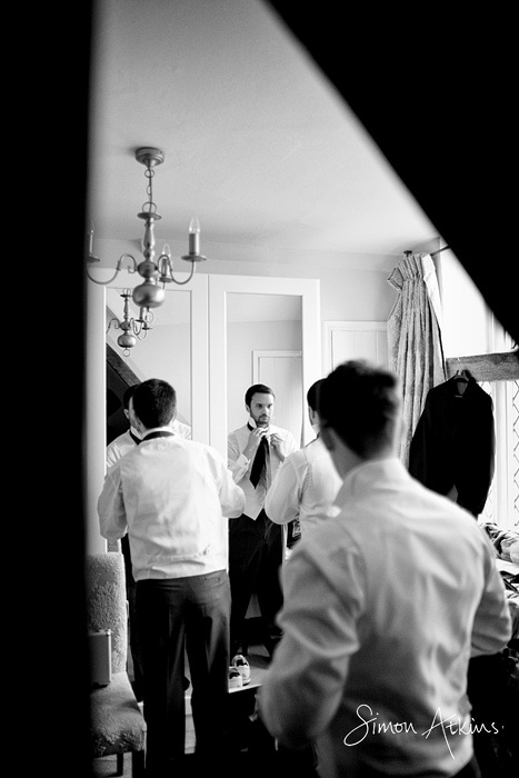 rushton hall wedding photos showing the groom getting ready