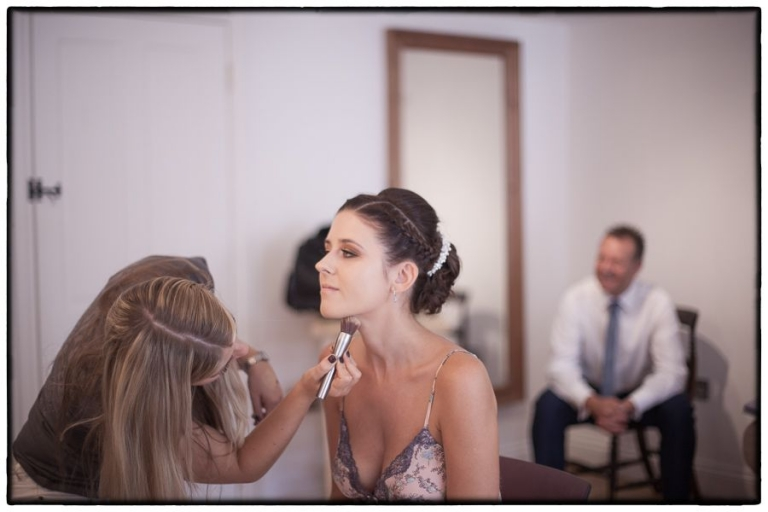 finishing touches to the brides makeup