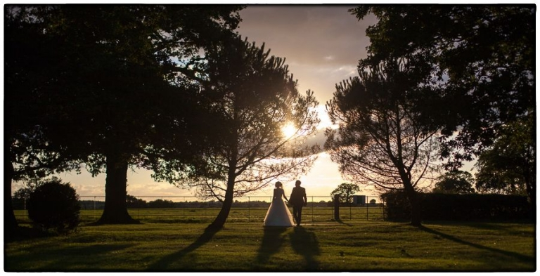 Blake Hall wedding photography, the happy couple taking a sunset walk in the grounds at Blake Hall.
