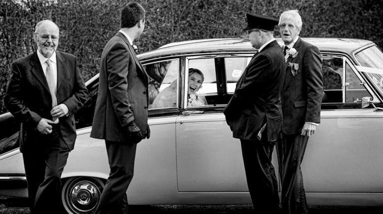 excited bride arriving for her wedding