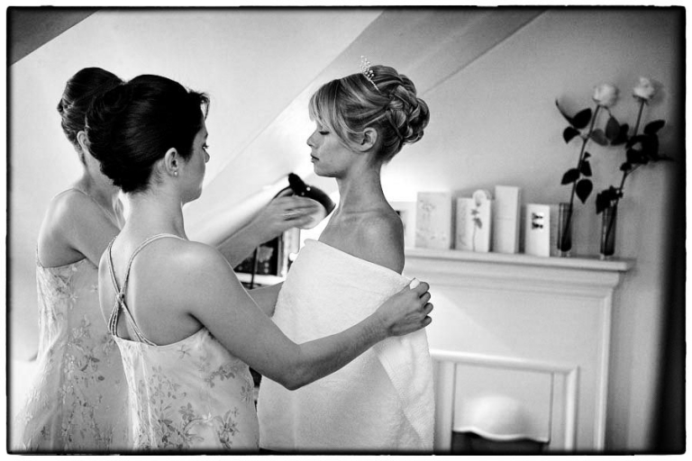 bride having her make up applied, Hampton Court House wedding photographer Simon Atkins.