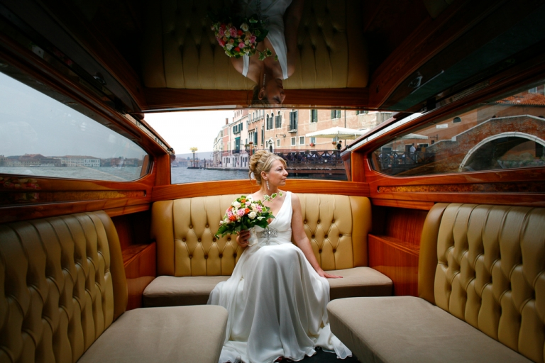 venice wedding photography, the bride in a water taxi on her way to the wedding ceromony