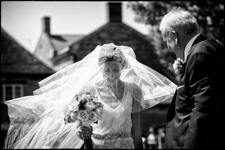 A storytelling moment showing the bride arriving for her wedding ceremony.
