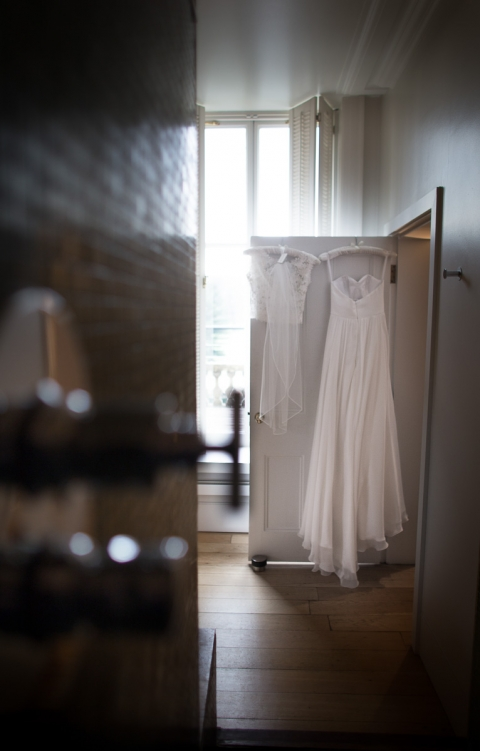 wedding dress hanging up at Cowley Manor